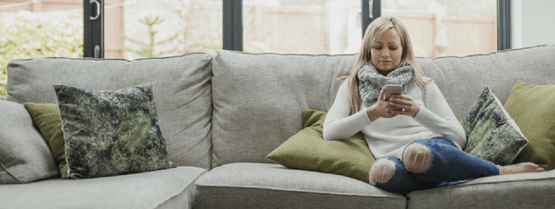 woman using smartphone on the sofa