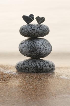 two hearts atop a stack of stones