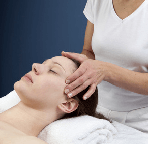 Healer with hands on client's head