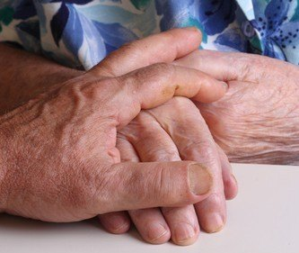 Compassion - one person holding another's hand