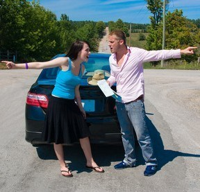 man and woman arguing over directions