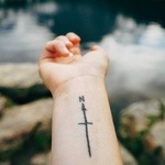 tattoo of north-pointing compass
