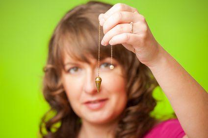 Woman holding a pendulum