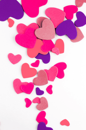 A shower of pink paper hearts