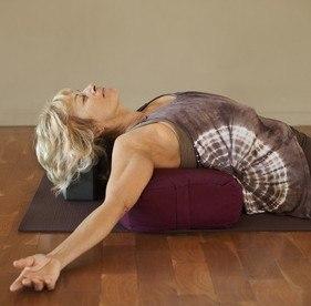 woman on a yoga bolster