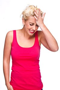 Woman smacking head